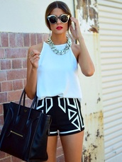 shorts,chic,bag,statement necklace,black shorts,celine,celine bag,round sunglasses,black,white,monochrome,geometric,black and white,aztec,spring break,black and white dress,t-shirt,tank top,fashion shorts,white-stitching,notjeanshorts,shapes,blue shorts,white shorts,fashion,patternedshorts,shirt,stylish,triangle,shape,chain bag