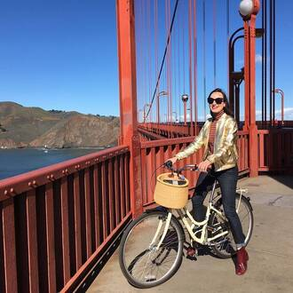 jacket gold leather jacket tumblr metallic gold bomber jacket jeans denim blue jeans cuffed jeans top red top stripes striped top bike boots ankle boots brown boots sunglasses striped turtleneck top