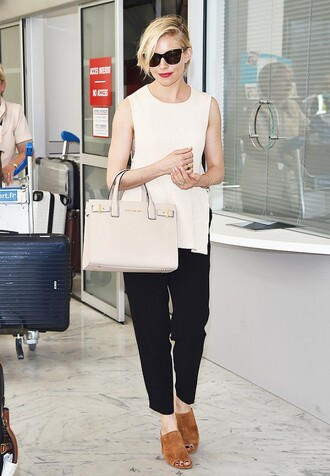 pants celebrity work outfits work outfits office outfits cropped pants black pants top white top sleeveless sleeveless top mules suede shoes bag nude bag handbag sunglasses cat eye black sunglasses celebrity style celebrity sienna miller