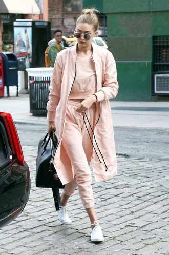 gigi hadid sweatpants pink top pink coat black bag model pants jacket rose pink