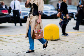 bag fashion week street style fashion week 2016 fashion week milan fashion week 2016 trench coat nude coat embellished bag embellished embroidered denim jeans blue jeans pointed flats flats black flats brown bag streetstyle fall outfits