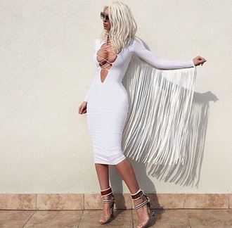 dress white dress tassel plunge v neck lace up blonde hair platinum hair cleavage long sleeves midi dress bodycon dress knee length dress lace up heels black heels jelenakarleusa jelena karleusa fringes