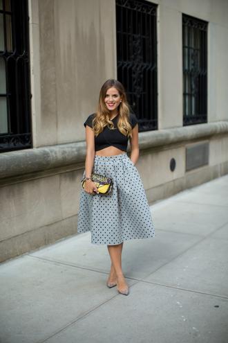top black crop top polka dot midi dress yellow purse grey heels blogger