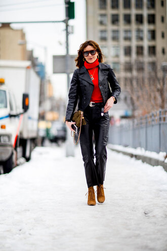 sweater nyfw 2017 fashion week 2017 fashion week streetstyle red sweater turtleneck turtleneck sweater pants black pants black leather pants leather pants boots brown boots lace up boots bag green bag jacket black jacket black leather jacket leather jacket sunglasses