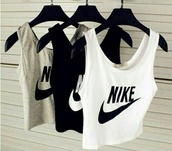 tank top,activewear,sportswear,running clothes,nike,shirt,top,black and white nike tank top,grunge,pale grunge,black and white,grunge t-shirt,pale,hipster,white crop tops,grey top,black top,crop,crop tops,white,grey,black,t-shirt,grey t-shirt,nikes