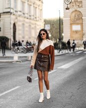 sweater,knitted sweater,oversized sweater,colorblock,mini skirt,snake print,zipped skirt,shoulder bag,ankle boots,white boots,sunglasses,earrings
