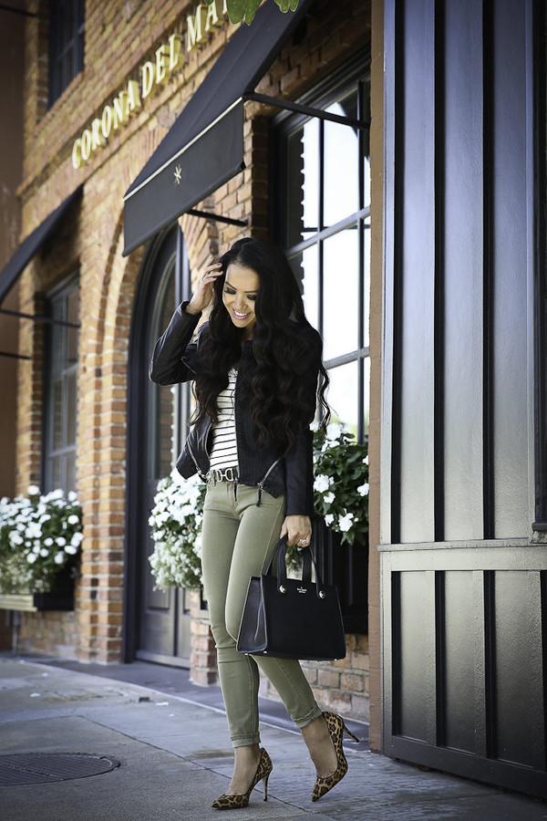 stylish petite blogger jacket sweater jeans shoes bag belt sunglasses fall outfits green pants faux leather jacket leather jacket high heel pumps pumps handbag
