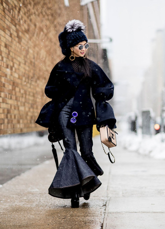 pants tumblr nyfw 2017 fashion week 2017 fashion week streetstyle kick flare blue pants boots black boots coat jacket black jacket oversized jacket oversized bell sleeves beanie pom pom beanie black beanie bag winter outfits winter jacket winter look
