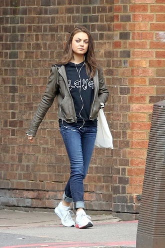 mila kunis army green jacket cropped jeans black sweater white sneakers