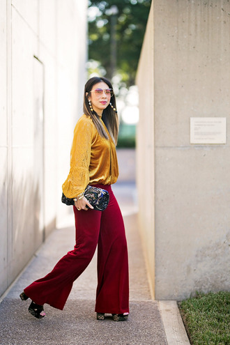 styleofsam blogger top jewels pants shoes sunglasses bag fall outfits red pants yellow top clutch