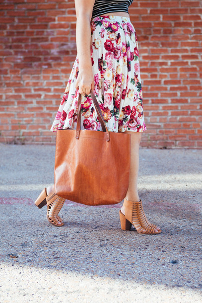 shoes blogger high heels summer outfits floral skirt skirt bag floral tote bag leather bag stripes midi skirt madewell kendi everyday handbag strappy sandals hipster hobo elegant caged sandals stacked wood heels midi floral skirt