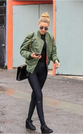 jacket bomber jacket gigi hadid sneakers leggings fall jacket fall outfits shoes athleisure gigi hadid bomber jacket gigi hadid leggings sage style puffer jackets gigihadidstyle new york city city outfits new year's eve winter outfits autumn/winter spring cute trendy dress black top green bomber jacket blogger black leggings
