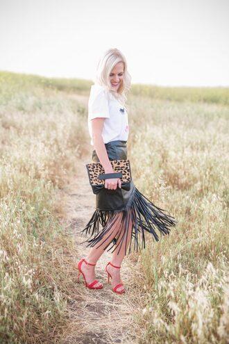 skirt fringe skirt faux leather skirt t-shirt graphic tee sandals clutch leopard print blogger blogger style