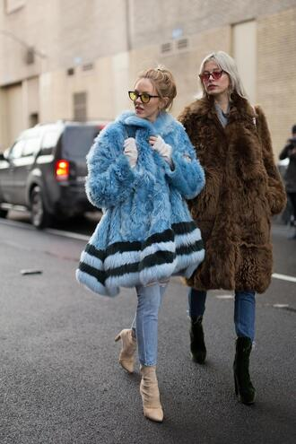 coat nyfw 2017 fashion week 2017 fashion week streetstyle blue coat fur coat brown coat brown big fur coat denim jeans blue jeans boots ankle boots velvet velvet boots velvet ankle boots sunglasses yellow sunglasses