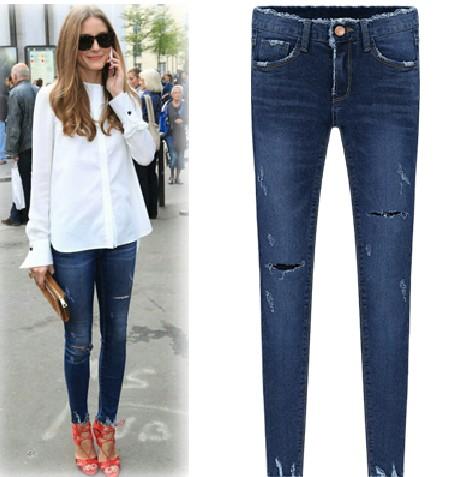 Torn dark blue skinny jeans from fashion struck on storenvy
