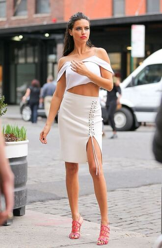 skirt lace up midi skirt crop tops crop adriana lima sandals make-up model lace up skirt slit skirt white skirt pencil skirt white crop tops white top sandal heels high heel sandals pink sandals off the shoulder