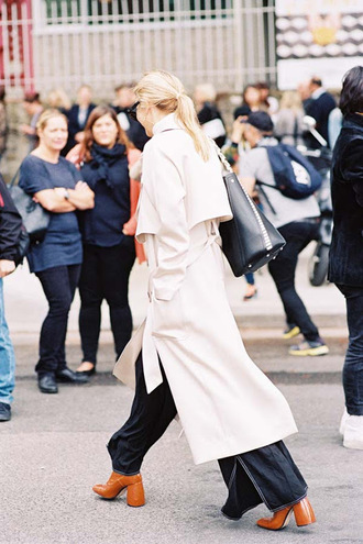 vanessa jackman blogger pants shoes coat trench coat wide-leg pants boots tumblr white coat long coat black pants brown shoes high heels thick heel block heels bag black bag white long coat
