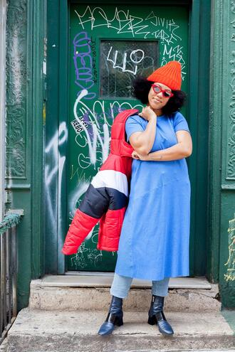 man repeller blogger tights skirt coat socks t-shirt shoes blue dress dress over pants beanie ankle boots puffer jacket