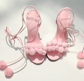 shoes,strappy heels,pink high heels,pom poms,baby pink high heels,high heel sandals,puffs,pink,blush,light pink,prissy,tie up,lace up heels,heels,girly,cute,pink heels