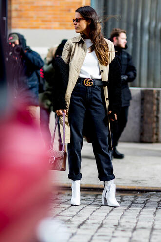 jeans nyfw 2017 fashion week 2017 fashion week streetstyle black jeans cropped jeans boots white boots ankle boots top white top coat camel camel coat trench coat