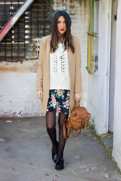 shoes and basics blogger camel coat knitted sweater leather backpack mini backpack beanie floral skirt mini skirt fall outfits tights black shoes beige coat