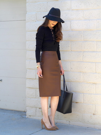 cost with me blogger hat top skirt shoes bag lace up bodysuit leather skirt midi skirt pencil skirt black top handbag black bag black hat suede shoes pumps long sleeve bodysuit