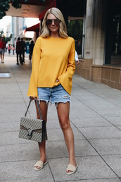 somewherelately,blogger,top,shorts,sunglasses,bag,bell sleeves,slide shoes,denim shorts,yellow top