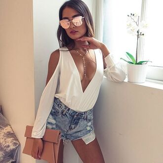 sunglasses low v neckline exposed shoulder mini shorts denim shorts rose gold cat eye clutch dusty pink top shorts bag