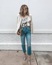 jeans,ripped jeans,cropped jeans,mules,printed t-shirt,logo,blazer,white blazer,snake print,clutch,sunglasses,starbucks coffee