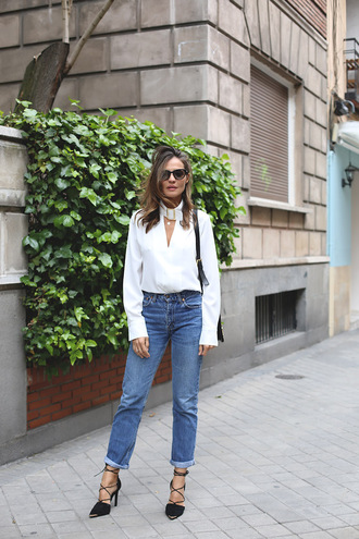 lady addict blogger bag shoes sunglasses shirt white top long sleeves high waisted jeans lace up heels black bag white blouse