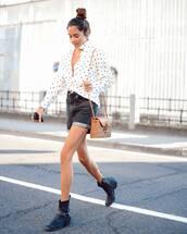 bag,shoulder bag,straw bag,cowgirl boots,boots,short shorts,polka dots,shirt,long sleeves,sunglasses