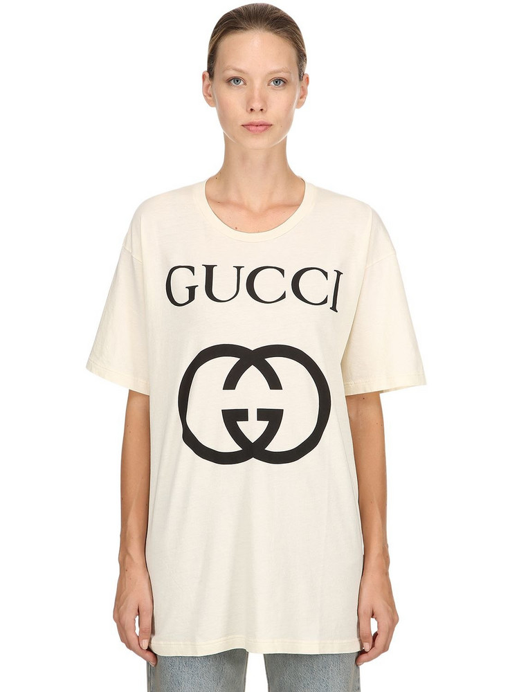 GUCCI Logo Printed Cotton Jersey T-shirt in black / ivory