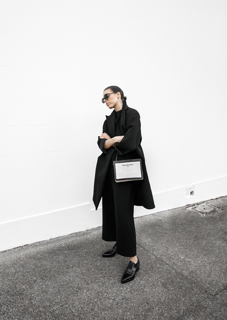 modern legacy blogger minimalist black jumpsuit black coat designer bag saint laurent