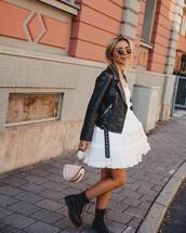 dress,white dress,ruffle dress,mini dress,boots,black boots,handbag,black jacket,leather jacket,biker jacket