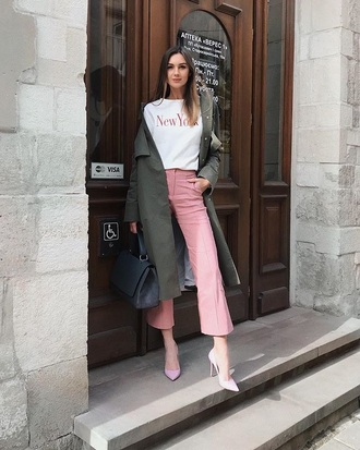 pants pink pants cropped pants coat green coat white t-shirt t-shirt pumps heels trench coat