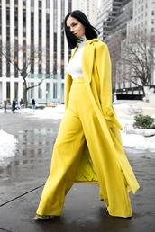 coat,nyfw 2017,fashion week 2017,fashion week,streetstyle,yellow coat,yellow,long coat,top,white top,white turtleneck top,turtleneck,pants,wide-leg pants,high waisted pants