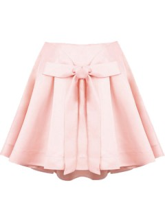 Pink bow front structured pleated skirt with extreme dip back