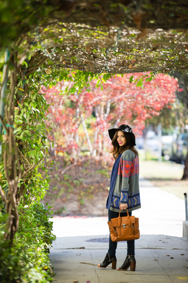 m loves m blogger top jeans cardigan bag jewels peep toe boots printed cardigan mustard hat fedora