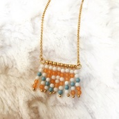 jewels,tassel,trendy,gold,orange,white,boho,bohemian,gold tone,beaded,gold jewelry,boho chic,longhorn necklace,necklace,choker necklace