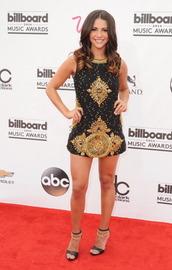 andi dorfman,gold embellishments,billboard,black and gold dress,embellished