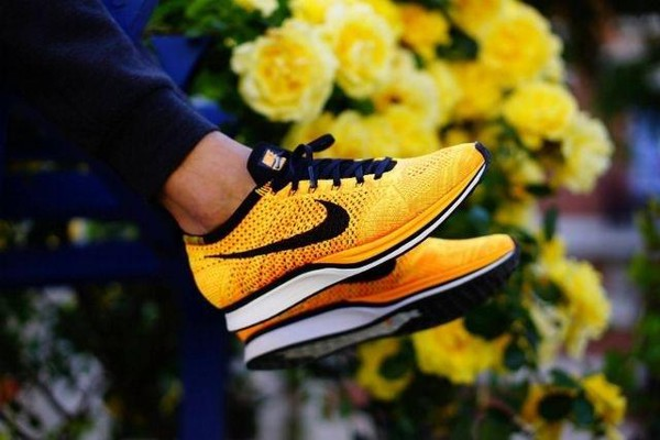 shoes nike sneakers running shoes running yellow orange nike nike running shoes black white shorts