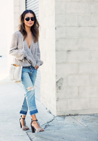 sweater grey sandals wrap top wrap sweater grey sweater jeans cropped jeans blue jeans bag grey bag sandals high heel sandals sandal heels sunglasses sincerely jules blogger