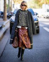 sweater,knitted sweater,printed sweater,white shirt,skirt,leather skirt,boots,handbag,coat,sunglasses