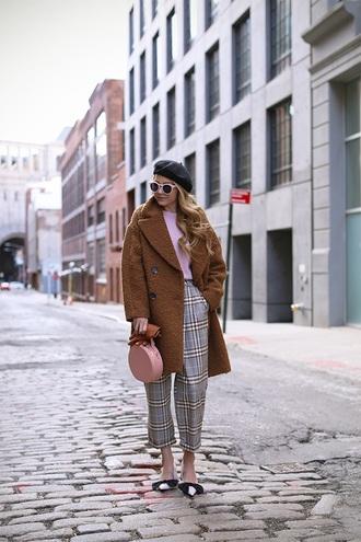 top pink top pants plaid plaid pants grey pants coat brown coat teddy bear coat beret sunglasses shoes