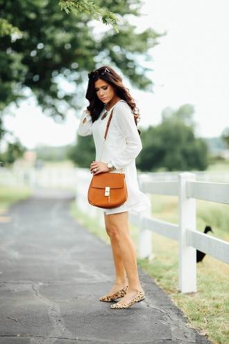 thesweetestthing blogger dress shoes jacket white dress long sleeve dress shoulder bag mini bag brown bag mini dress animal print flats