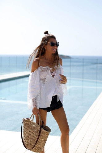 b a r t a b a c blogger white blouse off the shoulder black shorts summer outfits summer shorts raffia bag beach bag white off shoulder top white top off the shoulder top cat eye miu miu cut out shoulder white lace top lace top basket bag straw bag hun