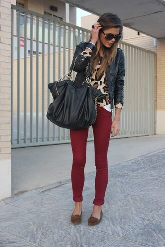 shirt black purse moccasins skinny pants sunglasses leopard print cheetah shirt ring straight hair burgundy maroon pants brown bracelets leather jacket bangle bracelet pants red lime sunday