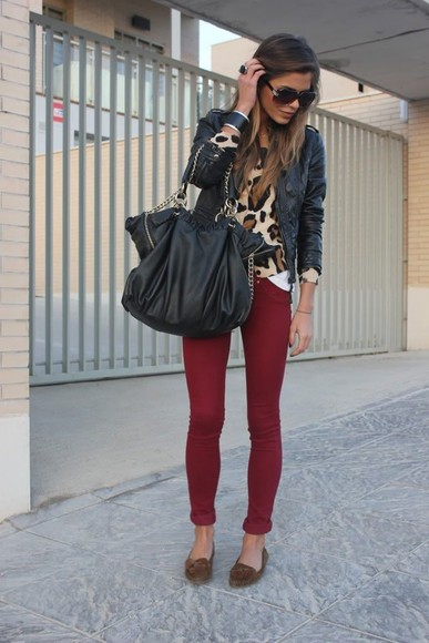 purse black shirt moccasins skinny pants sunglasses cheetah print cheetah shirt ring straight hair maroon maroon pants brown bracelet leather jacket bangle bracelet pants