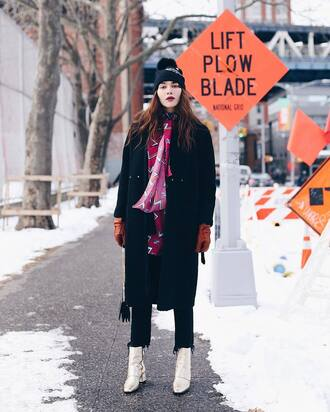 coat tumblr black coat scarf nyfw 2017 fashion week 2017 fashion week streetstyle leather gloves gloves boots metallic metallic shoes ankle boots mid heel boots jeans denim black jeans cropped jeans beanie pom pom beanie black beanie