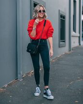 sweater,jumper,oversized sweater,knitwear,skinny jeans,jeans,high waisted jeans,converse,crossbody bag,round sunglasses,red sweater,knitted sweater,black bag,chanel bag